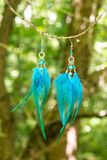 earrings of handmade dream catcher with feathers threads and beads rope hanging Royalty Free Stock Photography