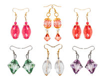 Earrings made of glass on a white background. six pairs Stock Image