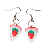 Earrings made of plastic in the form of the cake with strawberry Stock Photo