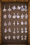Earrings on a market stall Stock Image