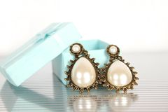 Earrings with pearls Royalty Free Stock Photos