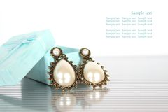 Earrings with pearls Stock Photography