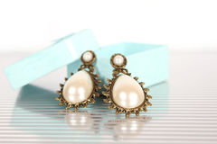 Earrings with pearls Royalty Free Stock Photography