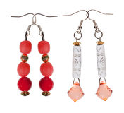 Earrings- pendants with sequins and red beads on white backgroun Stock Photo