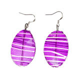 Earrings in purple glass on a white background Stock Image