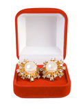 Earrings in red box. Isolate on white royalty free stock photo