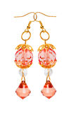 Earrings in red glass with gold elements. white background Stock Photos