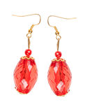 Earrings in red glass with gold elements. white background Royalty Free Stock Images