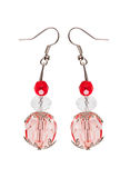Earrings in red glass with silver elements. white background Royalty Free Stock Photos