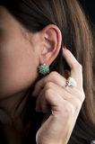 Earrings and ring with emerald. Silver collection of ring and earrings with emerald royalty free stock photo