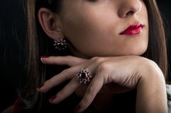 Earrings and ring with garnets. Model Portrait. Silver collection of ring and earrings with garnets Royalty Free Stock Image