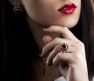 Earrings and ring with garnets. Portrait. Silver collection of ring and earrings with garnets Royalty Free Stock Photos