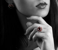 Earrings and ring with garnets. Silver collection of ring and earrings with garnets stock photography