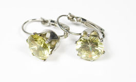 Earrings from silver with gems in rim Stock Image