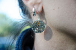 Earrings from watches Stock Image