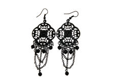 Earrings on white royalty free stock image