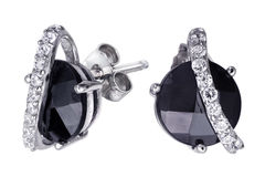 Earrings with zircon and expensive big gemstones Stock Photo