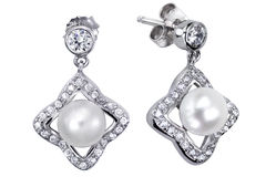 Earrings with zircon and expensive big pearl Stock Images