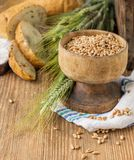 Ears of barley and wheat on the wooden background Royalty Free Stock Photography