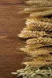 Ears of cereals on wood Royalty Free Stock Photos