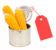 Ears of corn in a can with a label Stock Photo
