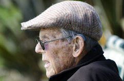 Ears hearing aid. Elderly man with hearing aid stock image