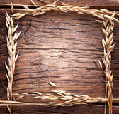 Ears Of Wheat Made As Frame On Old Wood. Stock Image