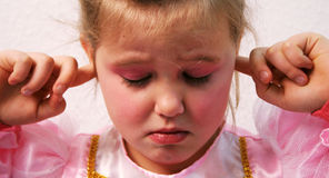 Ears of a Princess. Little princess is keeping her ears shut Stock Images