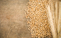 Free Ears Spike And Wheat On Wood Texture Royalty Free Stock Photos - 21105328