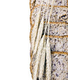 Ears of wheat are on the bread Royalty Free Stock Photos