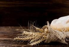 Ears of wheat in burlap are rolled up Royalty Free Stock Images