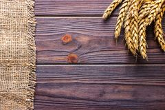 ears of wheat and cloth on wooden background stock photo