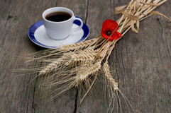 Ears of wheat and coffee on a saucer, a still life Royalty Free Stock Photography