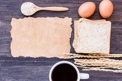 Ears of wheat,egg,old paper and cup of coffee with slice of brea Royalty Free Stock Photo