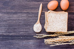 Ears of wheat and egg with slice of bread stock photo