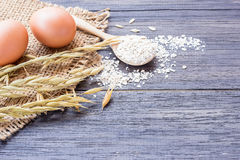 Ears of wheat and egg on a wooden table stock photos