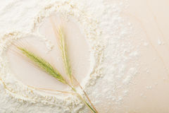 Ears of wheat in flour on a bread board, Cooked with love, heart Royalty Free Stock Photos