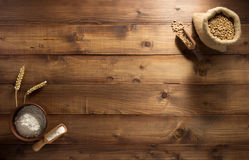 Ears and wheat flour on wood. En background texture Royalty Free Stock Images
