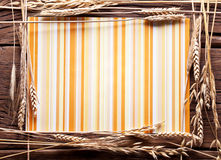 Ears of wheat  in the form of frame on old wood. Royalty Free Stock Image