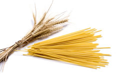 Ears of wheat and linking of spaghetti, isolate Royalty Free Stock Photography