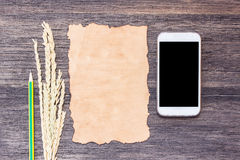 Ears of wheat and old paper with cup of coffee royalty free stock photo