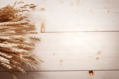 Ears of wheat on old wood. Royalty Free Stock Photo