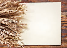 Ears of wheat on old wood. Stock Photography