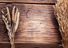 Ears of wheat on old wood. Royalty Free Stock Images