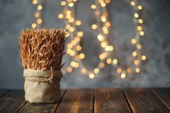 Ears of wheat on old wooden table Royalty Free Stock Photo