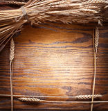 Ears of wheat on old wooden table. Royalty Free Stock Photography