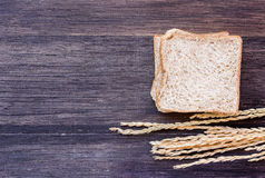 Ears of wheat and slice of bread royalty free stock photography