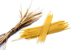 Ears of wheat and two linking of spaghetti Stock Photo