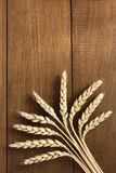 Ears of wheat on wood Stock Images