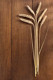 Ears of wheat on wood Stock Image